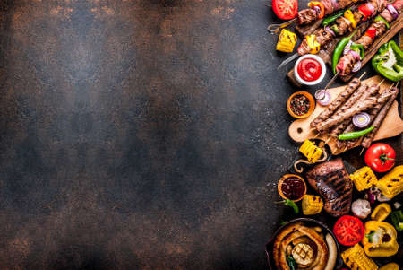Photo pour Assortment various barbecue food grill meat, bbq party fest - shish kebab, sausages, grilled meat fillet, fresh vegetables, sauces, spices, dark rusty concrete table, above copy space - image libre de droit