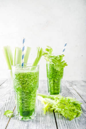 Photo for Healthy vegan food and drink. Diet green cucumber and celery smoothie cocktail, on a wooden background, - Royalty Free Image