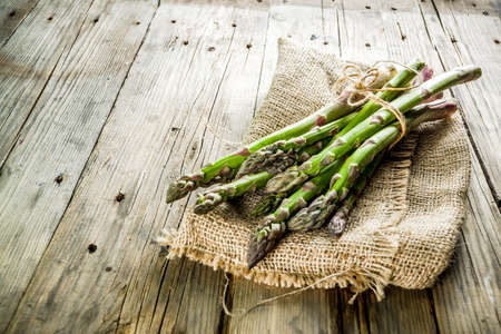 Photo for Fresh organic farm asparagus bunch on wooden rustic background - Royalty Free Image