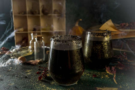 Photo for Halloween party drink idea, Witches Brew Black Sangria on Halloween styled table - Royalty Free Image