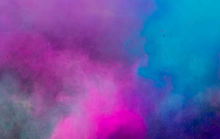 Photo pour powder in different colours thrown into the air forming a huge cloud of smoke with little bits - image libre de droit