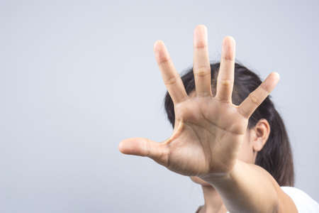 Photo for Woman hand doing a stop gesture on grey background - Royalty Free Image