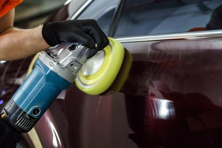 Foto de Car surface buffing. Renewing using polish machine. - Imagen libre de derechos