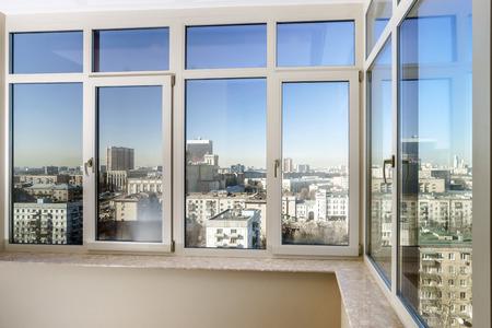 Photo pour View to the city through new glass windows - image libre de droit