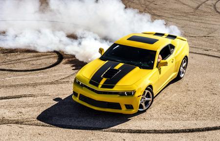 Photo pour Luxury yellow sport car drifting, motion capture - image libre de droit