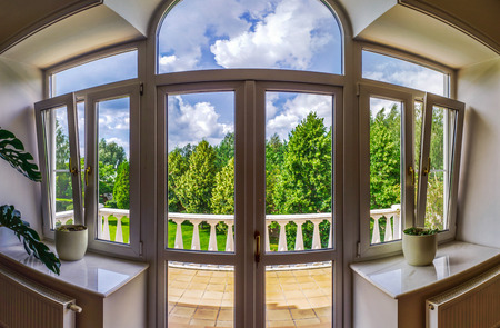 Photo pour New pvc windows in old-styled interior, view from the inside - image libre de droit