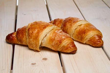Foto de A pair of fresh croissant on the table - Imagen libre de derechos