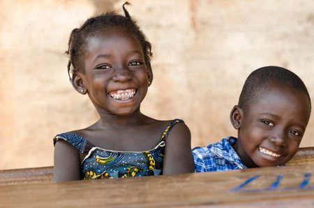 Photo pour Happiness Symbol: Couple of African Children Laughing at School - image libre de droit
