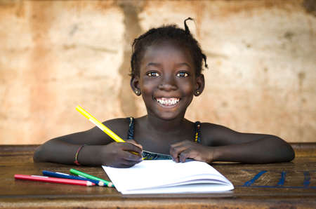 Photo pour Education Symbol: Big Toothy Smile on African School Girl - image libre de droit