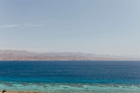Foto per Landscape views of Israeli city Eilat. City of vacations, diving, fishing, Eilat is also critical point of import/export to Israel. - Immagine Royalty Free