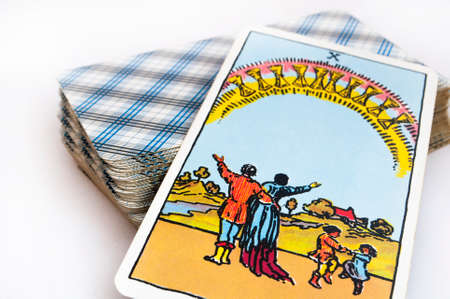 Photo pour the deck of Tarot cards on white background, top down card ten of cups - image libre de droit