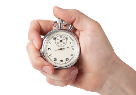 Photo pour Close up of hand holding stopwatch - image libre de droit