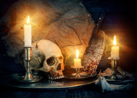 Photo pour On wooden background skull and candles - image libre de droit