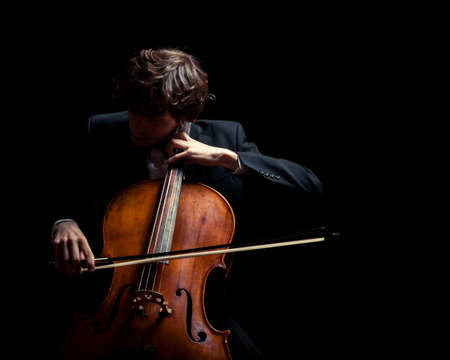 Photo for musician playing the cello. Black background - Royalty Free Image