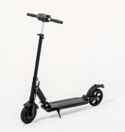 Foto de Electric scooter isolated on white background. Black color - Imagen libre de derechos