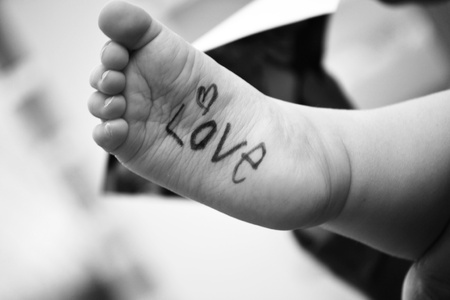Baby s foot with word love written on it