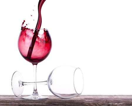 Photo for pair of full and empty wine glasses - Royalty Free Image