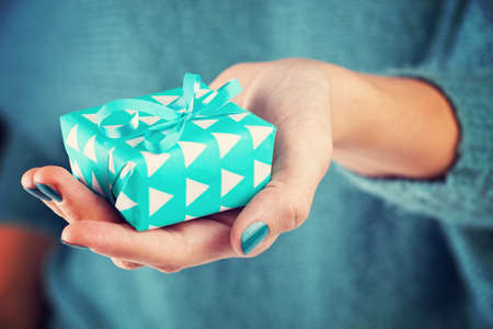 Photo for Close-up of female hand holding a present - Royalty Free Image