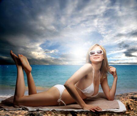 beautiful woman in bikini laying on the beach