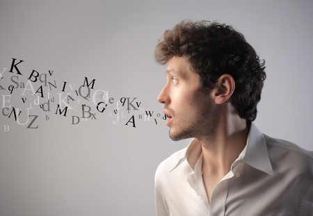 Photo pour Young man talking with alphabet letters coming out of his mouth - image libre de droit