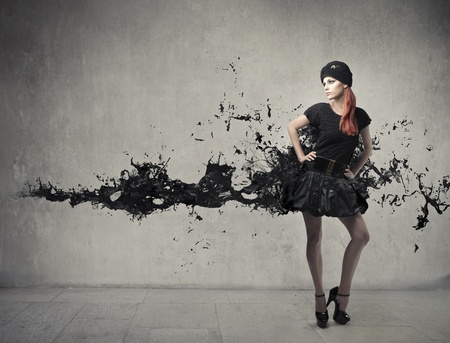 Foto für Elegant beautiful woman with her dress melting in black paint - Lizenzfreies Bild