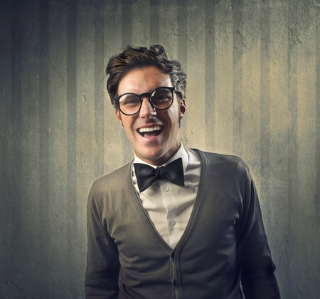 Fashionable man with a black tie laughing