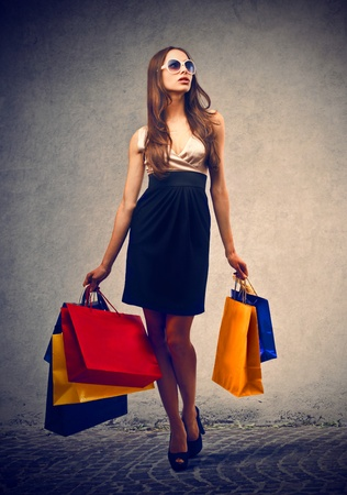 Photo for pretty woman goes shopping - Royalty Free Image
