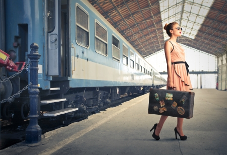 Foto de beautiful woman getting off the train - Imagen libre de derechos