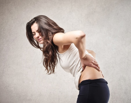 Photo for young woman with backache - Royalty Free Image