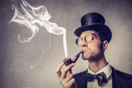 Foto de rich handsome man smoking a pipe - Imagen libre de derechos