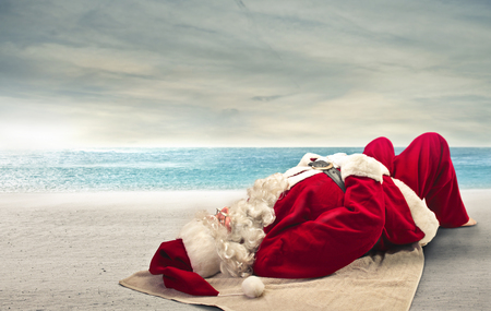 Photo for Santa Klaus relaxing on the beach - Royalty Free Image