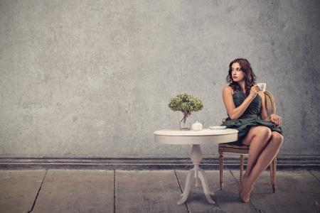 Photo pour young beautiful woman waiting sitting on a chair - image libre de droit