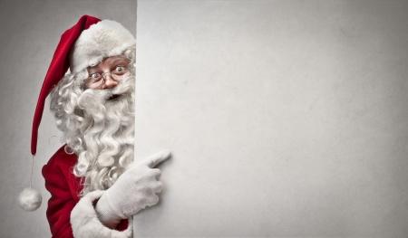 Photo pour Santa Klaus showing something - image libre de droit