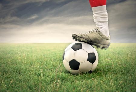 Photo pour Soccer player legs with ball - image libre de droit