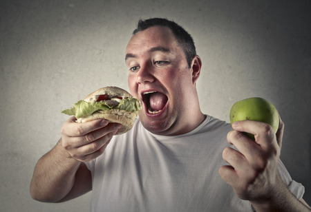 Photo pour Apple and hamburger - image libre de droit