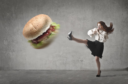 Photo pour Kicking a hamburger - image libre de droit