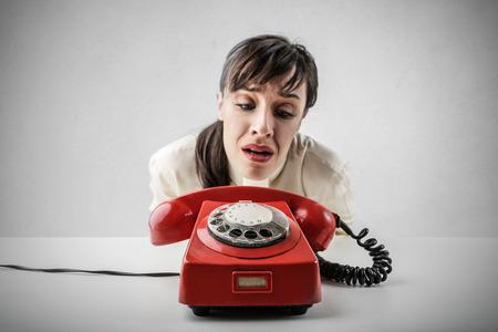 Photo pour Desperate woman waiting for a phone call - image libre de droit