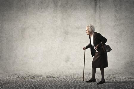 Photo pour Elderly woman walking - image libre de droit