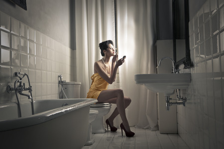 Photo for Woman in a bathroom - Royalty Free Image