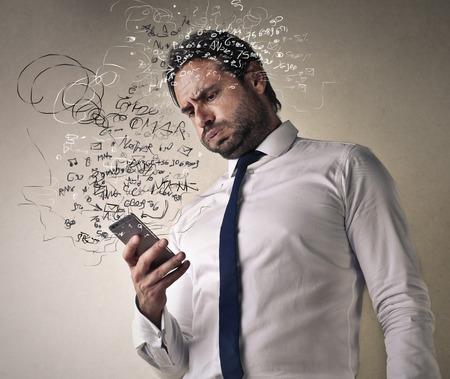 Photo pour Confused businessman checking his smart phone - image libre de droit