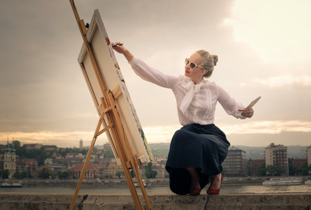 Photo for Woman painting on canvas - Royalty Free Image