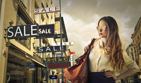 Photo pour Woman going shopping - image libre de droit