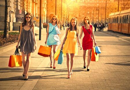 Photo pour Four friends walking in the street - image libre de droit