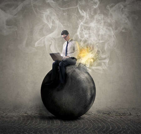 Photo pour Businessman sitting on a bomb - image libre de droit