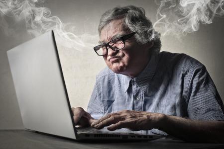 Foto de Elderly man using technology - Imagen libre de derechos