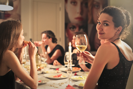 Photo pour Woman at an elegant dinner - image libre de droit