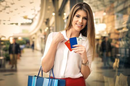 Photo pour Credit cards in the shopping center - image libre de droit