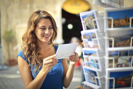 Photo pour Choosing a nice postcard - image libre de droit