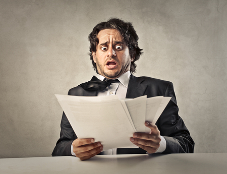 Foto de Scared manager looking at some documents - Imagen libre de derechos