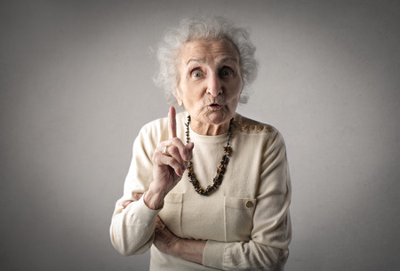 Foto de Severe grandmother pointing at someone - Imagen libre de derechos